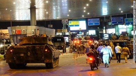Military vehicles enter Istanbul Ataturk Airport following an attempted coup attempt in Turkey.