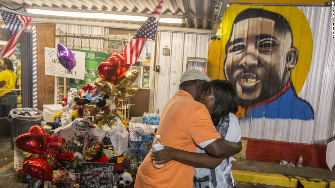 Sandra Sterling, Alton Sterling's aunt, visits the memorial for him at the Triple S Food Mart in Baton Rouge, Louisiana, on July 7.