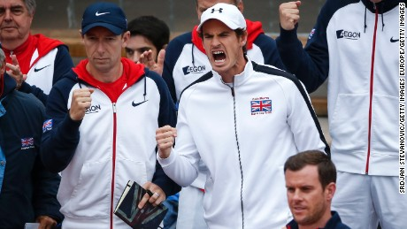 Wimbledon champion Andy Murray cheered on from the sidelines as Edmund clinched a semifinal place for GB.