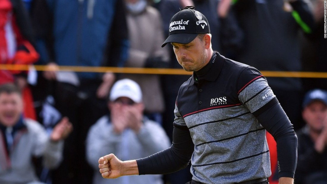 Sweden's Stenson reacts after making his birdie putt on the 14th green during his triumphant final round at the British Open.