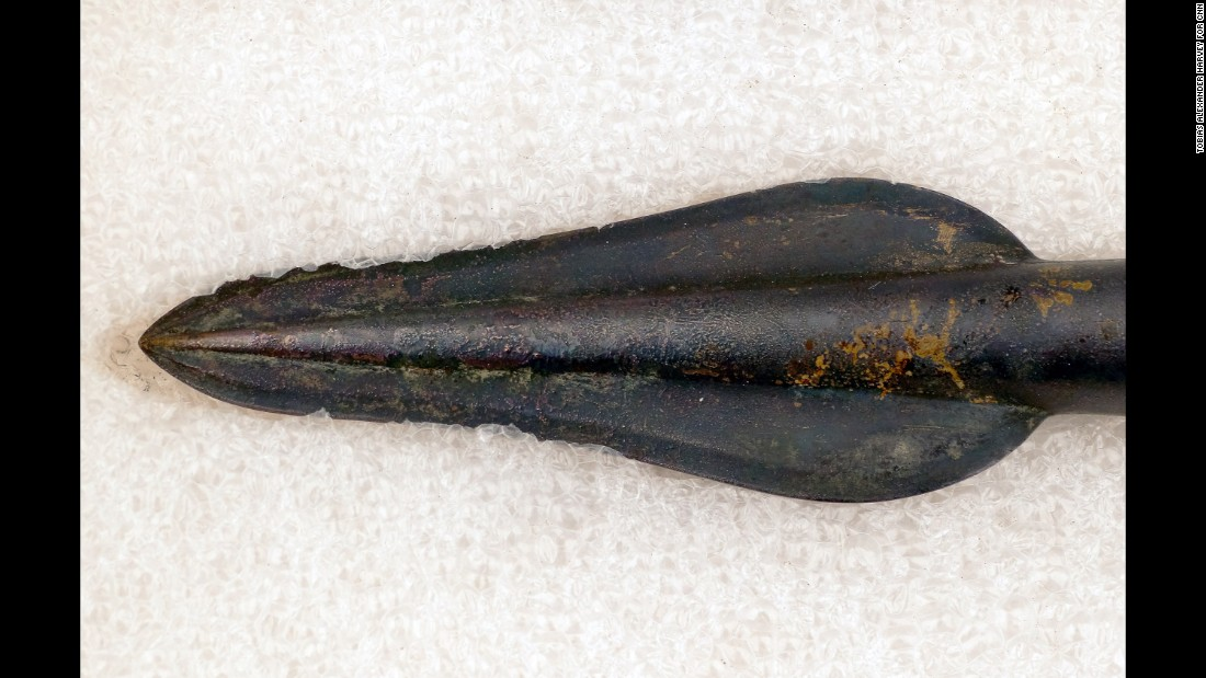 This bronze spear head was discovered with part of its shaft intact.