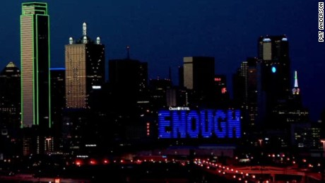 """A Dallas hotel displays the words """"Enough"""" after the police attack."""