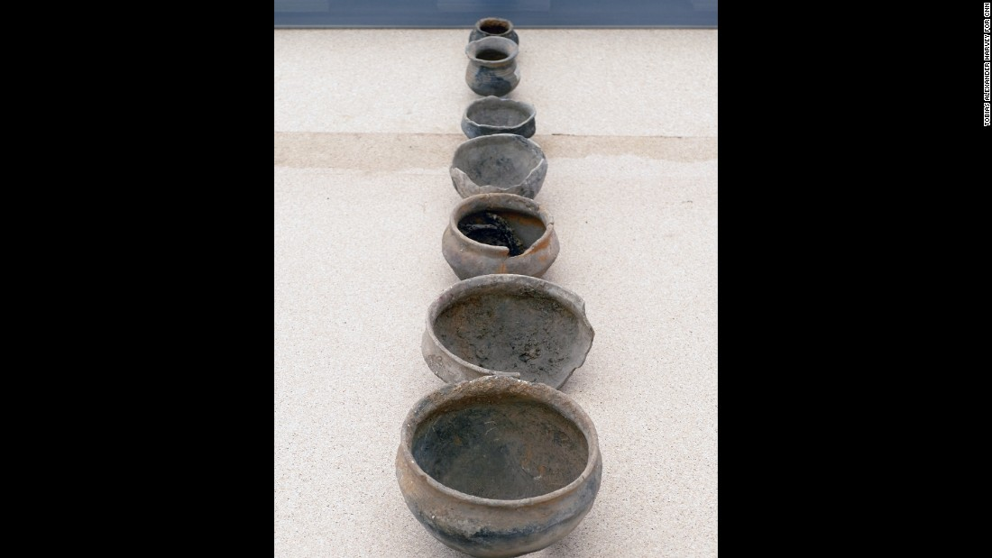 The consistent design of these small clay pots suggests they were made by the same potter.