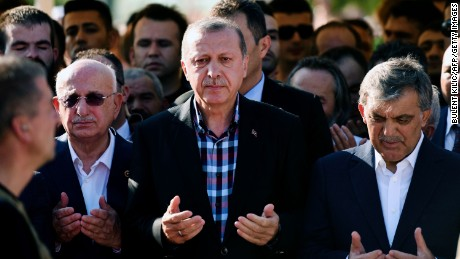 Turkey's President Recep Tayyip Erdogan and former Turkish president Abdullah Gul pray during the funeral of a victim of the coup attempt in Istanbul on July 17.