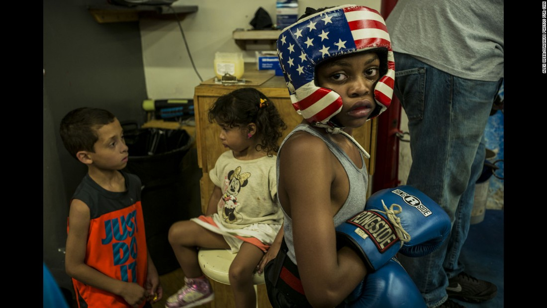 """""""The boxing gym felt like a safe haven in a very troubled world,"""" photographer Alex Webb said. """"Kids of all ages came to the gym -- the youngest simply to hang out, the older ones to box."""""""