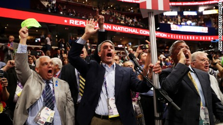 Former Virginia Attorney General Ken Cuccinelli (L) along with other delegates from Virginia chant for a rule call vote on the first day of the Republican National Convention on July 18, 2016 at the Quicken Loans Arena in Cleveland, Ohio. An estimated 50,000 people are expected in Cleveland, including hundreds of protesters and members of the media. The four-day Republican National Convention kicks off on July 18.
