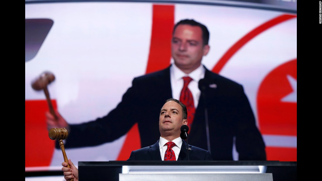 Reince Priebus, chairman of the Republican National Committee, bangs a gavel as resolutions are adopted at the start of the convention.