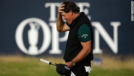Phil Mickelson of the United States reacts after missing a birdie putt on the 18th green during the first round of the British Open Golf Championships at the Royal Troon Golf Club in Troon, Scotland, Thursday, July 14, 2016. (AP Photo/Matt Dunham)