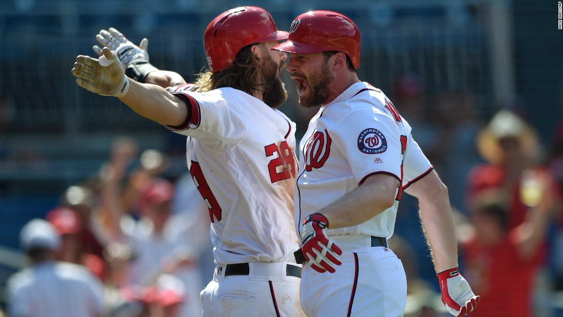 Daniel Murphy, right, celebrates with Washington teammate Jayson Werth after hitting a home run against Pittsburgh on Sunday, July 17. Pittsburgh would go on to win the game in 18 innings.