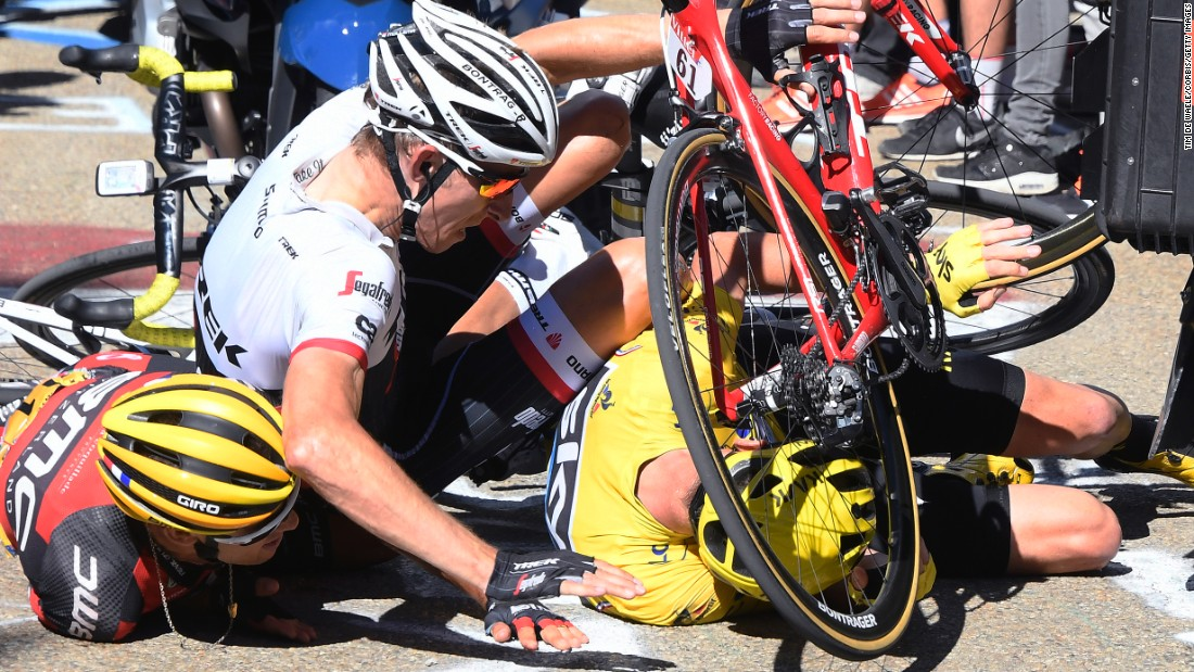 Richie Porte, left, was competing in the 12th stage of the Tour de France when he crashed into a TV motorcycle that slowed down in front of him on Thursday, July 14. The crash also took out Bauke Mollema, center, and overall leader Chris Froome, right.