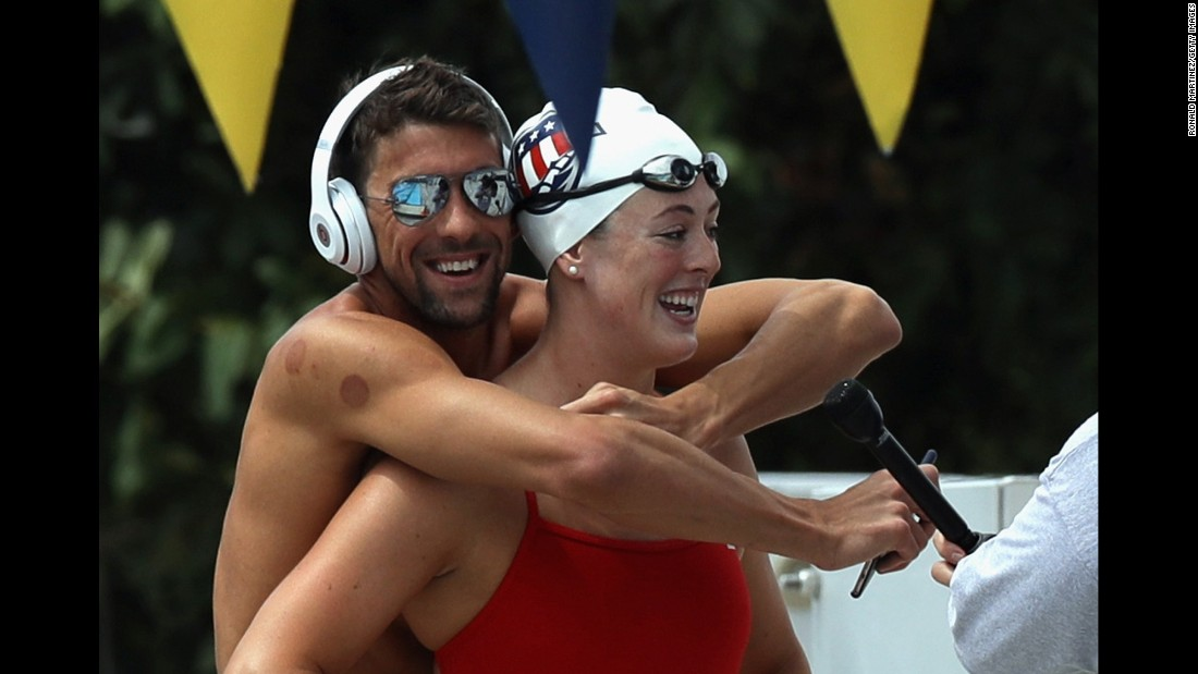 Michael Phelps hugs Allison Schmitt as she is interviewed Saturday, July 16, in San Antonio. It was media day for the U.S. Olympic swimming team.