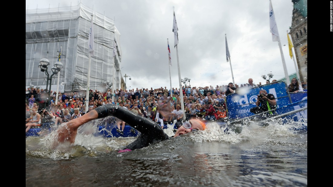 A triathlete in the Mixed Relay World Championship swims in Hamburg, Germany, on Sunday, July 17.