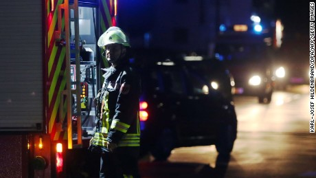 Rescuers gather on a road near railtracks in Wuerzburg southern Germany after a man attacked train passengers with an ax.