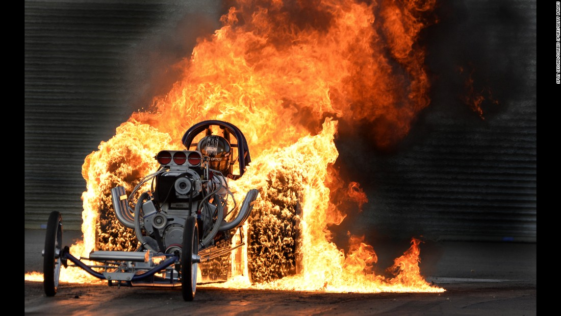 Bob Hawkins performs a flaming burnout during the Dragstalgia event in Wellingborough, England, on Saturday, July 16.