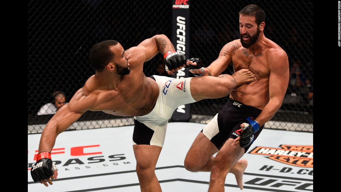 Devin Clark kicks Alex Nicholson during a UFC event in Sioux Falls, South Dakota, on Wednesday, July 13. Nicholson won with a first-round knockout.