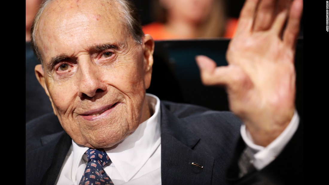 Former U.S. Sen. Bob Dole, the GOP's presidential nominee in 1996, waves after listening to a speech on Monday.