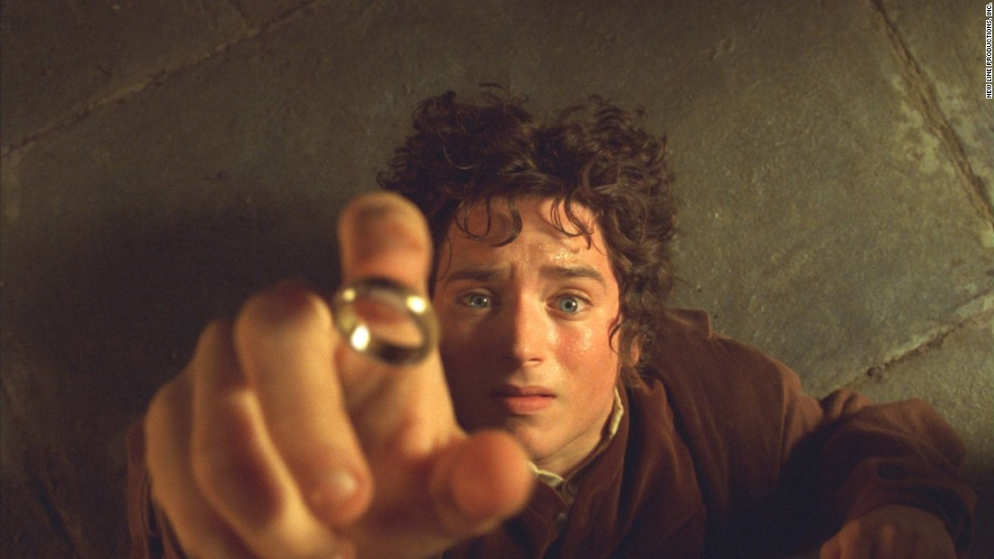 """Actor Elijah Wood as Frodo Baggins in """"The Lord of the Rings: The Fellowship of the Ring"""" with the One Ring, which makes the wearer invisible."""