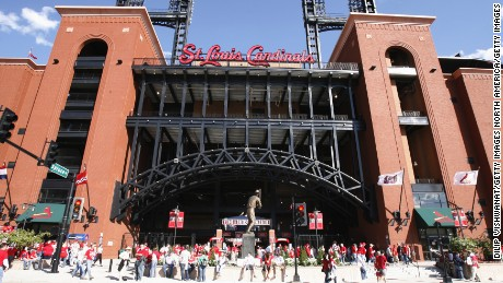 ST. LOUIS - APRIL 1:  Fans mill around outside Busch Stadium before the St. Louis Cardinals game against the New York Mets during their Opening Day game on April 1, 2007 at Busch Stadium in St. Louis, Missouri.  The Mets beat the Cards 6-1.  (Photo by Dilip Vishwanat/Getty Images)