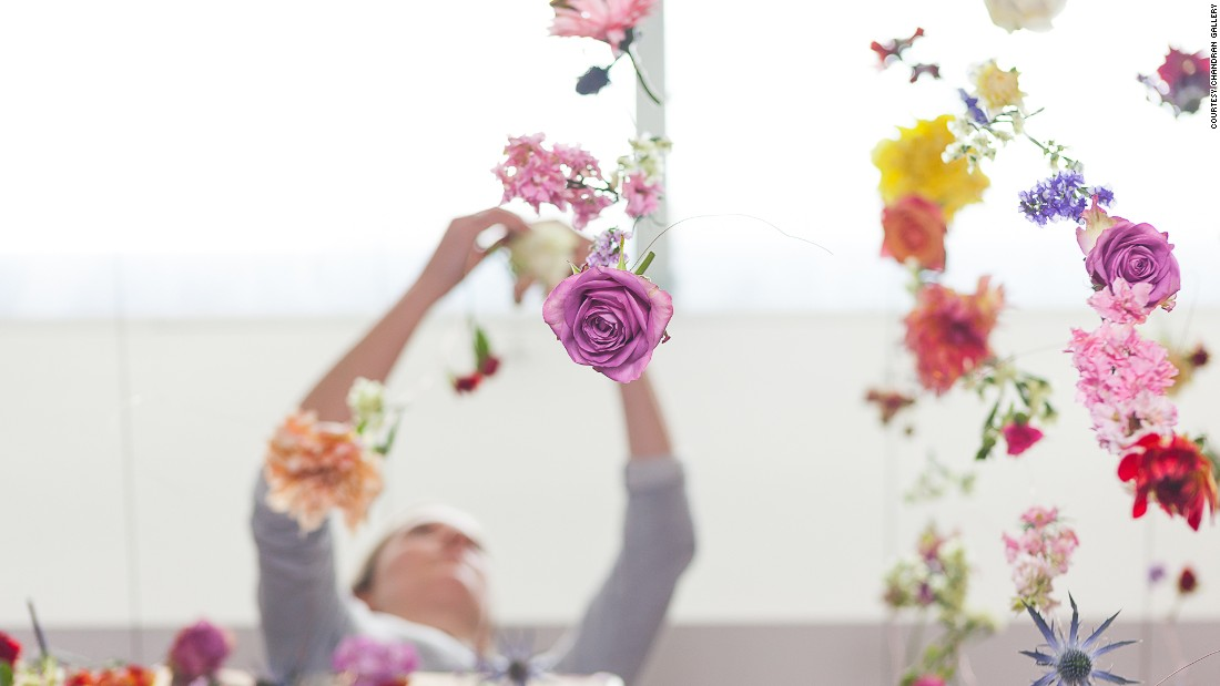 Waste is not an option for the artist, who requests that flowers from old installations be turned into smaller works encased in glass, hung in bunches, or returned to her to be incorporated in new works.