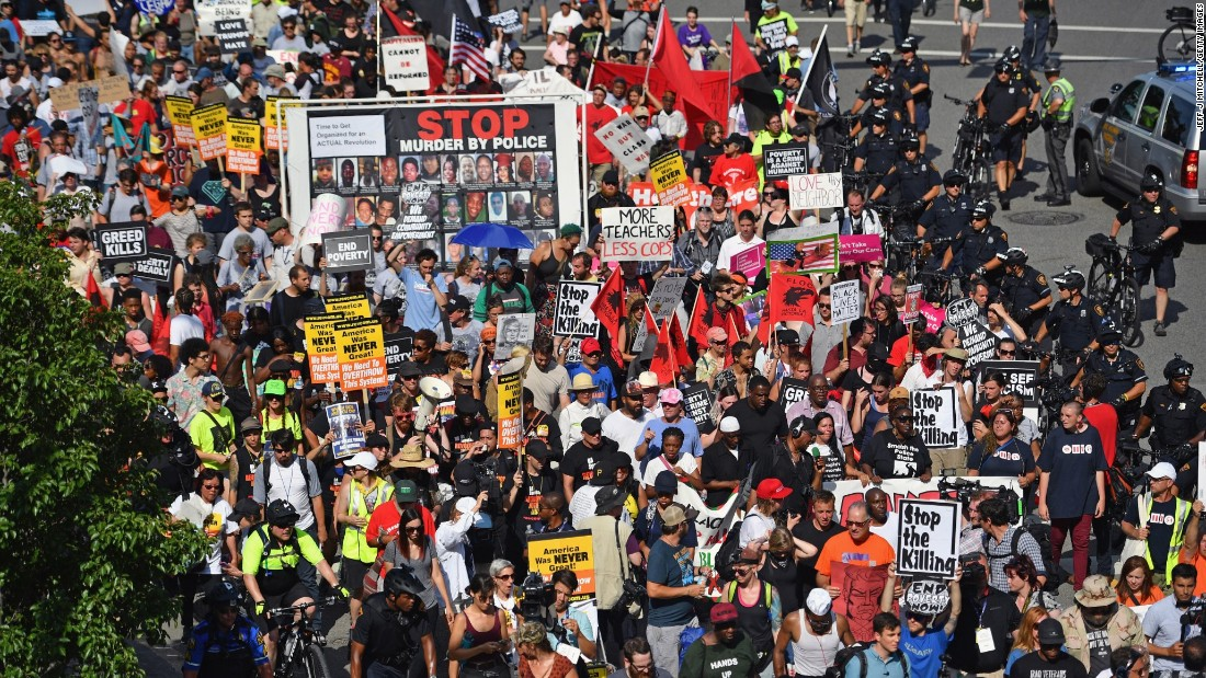 Protesters from the End Poverty Now campaign march in downtown Cleveland on Monday.