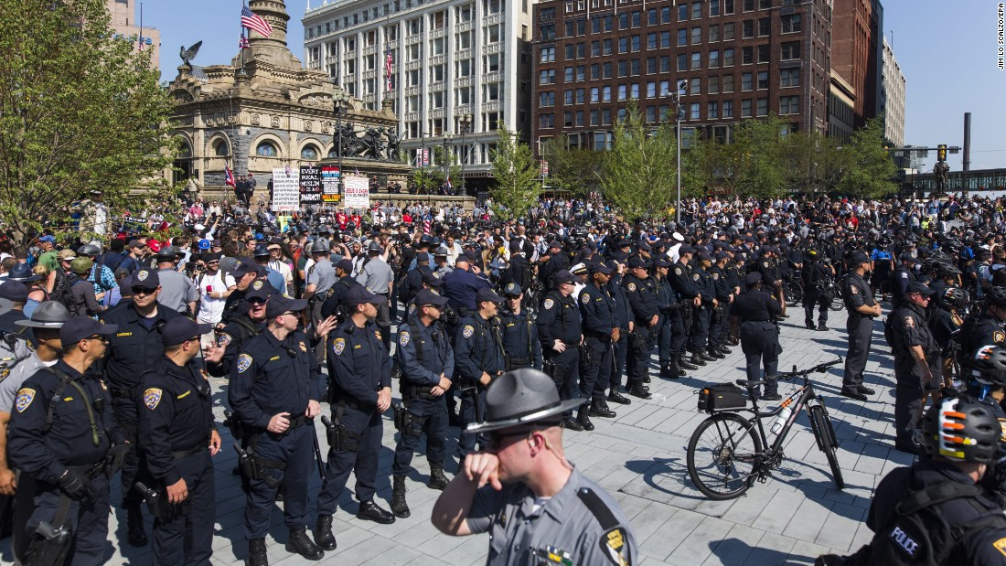 Police separate protesters in Cleveland's Public Square on Tuesday, July 19. Various groups are protesting in the city, which is hosting the Republican National Convention this week.