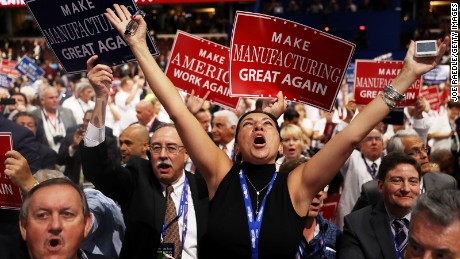 \Delegates celebrate after the Speaker of the House Paul Ryan announces the official nomination of Republican presidential candidate Donald Trump on the second day of the Republican National Convention on July 19, 2016 at the Quicken Loans Arena in Cleveland, Ohio. Republican presidential candidate Donald Trump received the number of votes needed to secure the party's nomination. An estimated 50,000 people are expected in Cleveland, including hundreds of protesters and members of the media. The four-day Republican National Convention kicked off on July 18.\