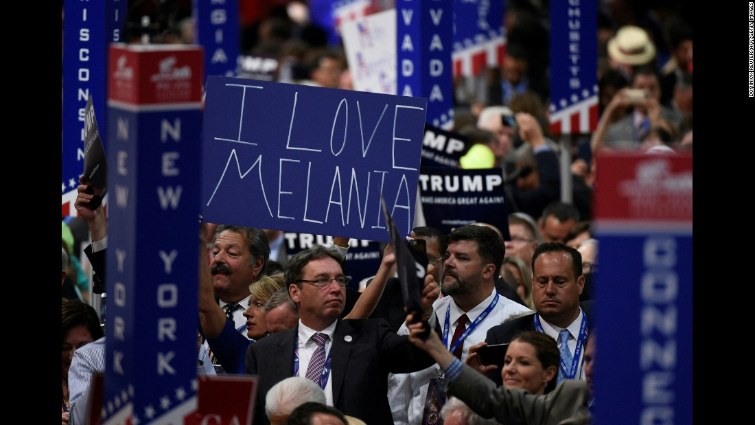 A delegate shows support for Donald Trump's wife, Melania, on Tuesday.
