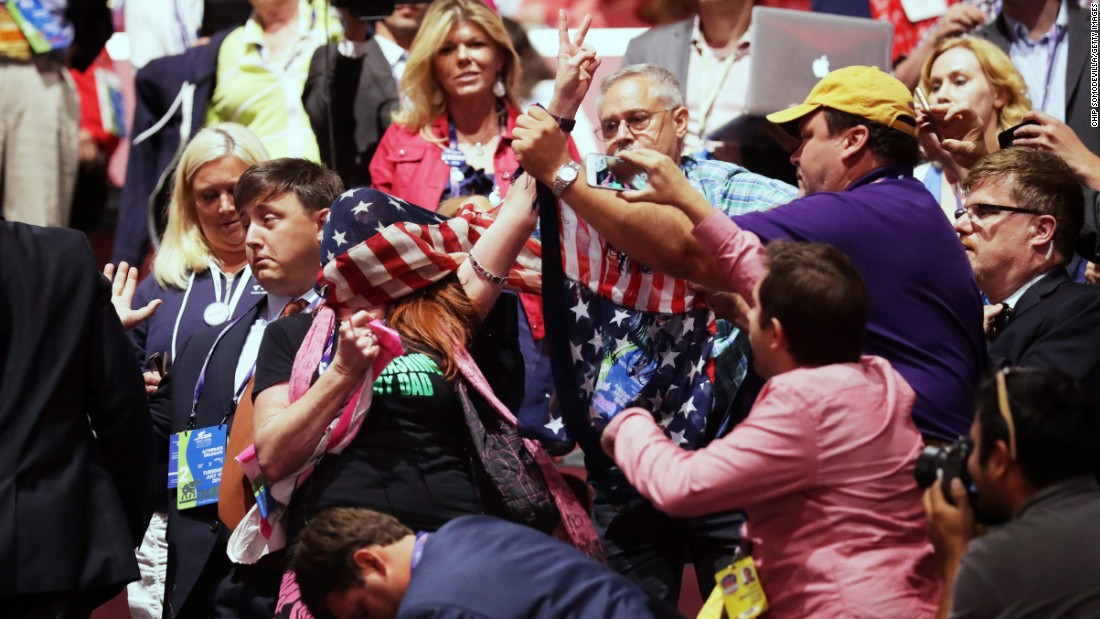 A member of the activist group Code Pink protests inside the arena during Carson's speech.