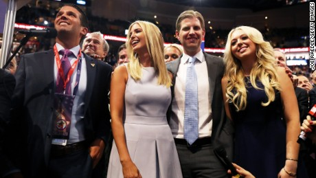 Donald Trump Jr. (L), along with Ivanka Trump (C), Eric Trump (2nd-R) and Tiffany Trump (R), take part in the roll call in support of Republican presidential candidate Donald Trump on the second day of the Republican National Convention on July 19, 2016 at the Quicken Loans Arena in Cleveland, Ohio. An estimated 50,000 people are expected in Cleveland, including hundreds of protesters and members of the media. The four-day Republican National Convention kicked off on July 18.