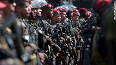 Brazilian Paratrooper Brigade soldiers, who will be deployed during the Olympic games, are presented during a ceremony in Rio de Janeiro, Brazil, Friday, July 8, 2016. Roughly twice the security contingent at the London Olympics will be deployed during the August games in Rio, which are expected to draw thousands of foreigners to a city where armed muggings, stray bullets and turf wars between heavily armed drug gangs are routine. (AP Photo/Silvia Izquierdo)