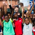 Charlize Theron with youth from Whizzkids United