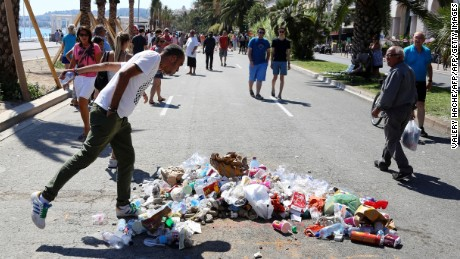Trash piles up at the place where police killed attacker Mohamed Bouhlel in Nice, France.