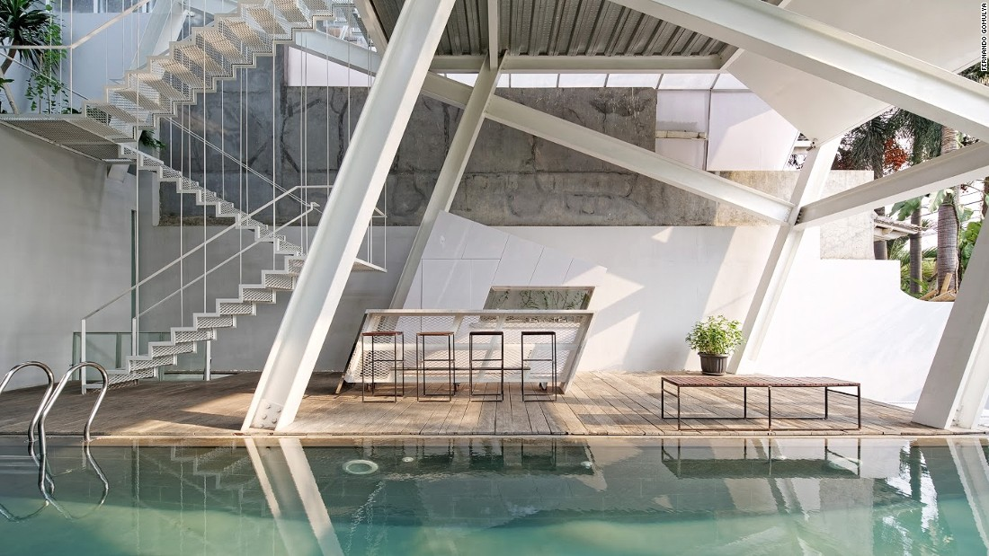 """The open-plan ground floor features a stunning pool. Budi Pradono is proud of this entry point to the property, saying it has an undeniable """"wow factor."""""""