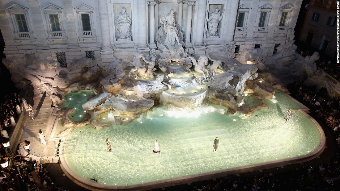 Karl Lagerfeld and Fendi wowed the fashion world with a show-stopping display of couture presented on a glass walkway that curved across the Trevi Fountain.