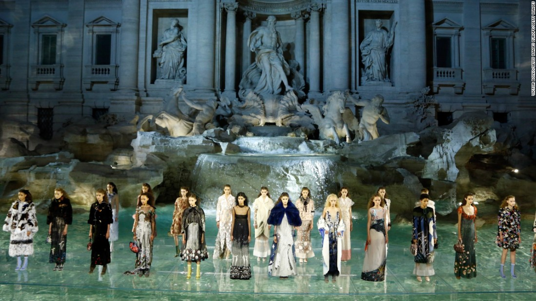 Models stand in their final looks at the show staged to mark Fendi's 90th anniversary.
