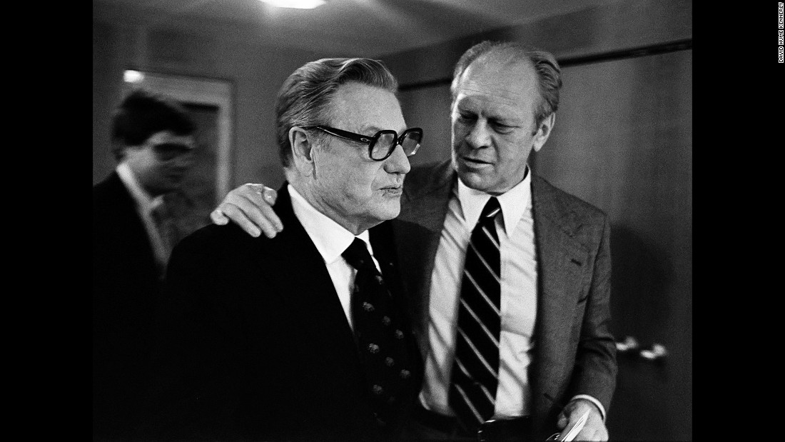 "Ford puts his arm around Vice President Nelson Rockefeller in Kansas City. Before the convention, Ford dropped Rockefeller from his ticket. ""Advisers felt -- and (Ford) ultimately agreed -- that he needed a more conservative running mate to offset Reagan,"" Kennerly said. Rockefeller's replacement was U.S. Sen. Bob Dole from Kansas."