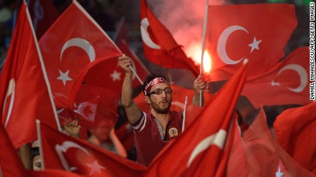 Turkish flags turn Taksim Square into a sea of red.
