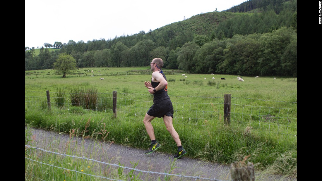 The race winds through verdant, rolling, sheep-speckled hills.