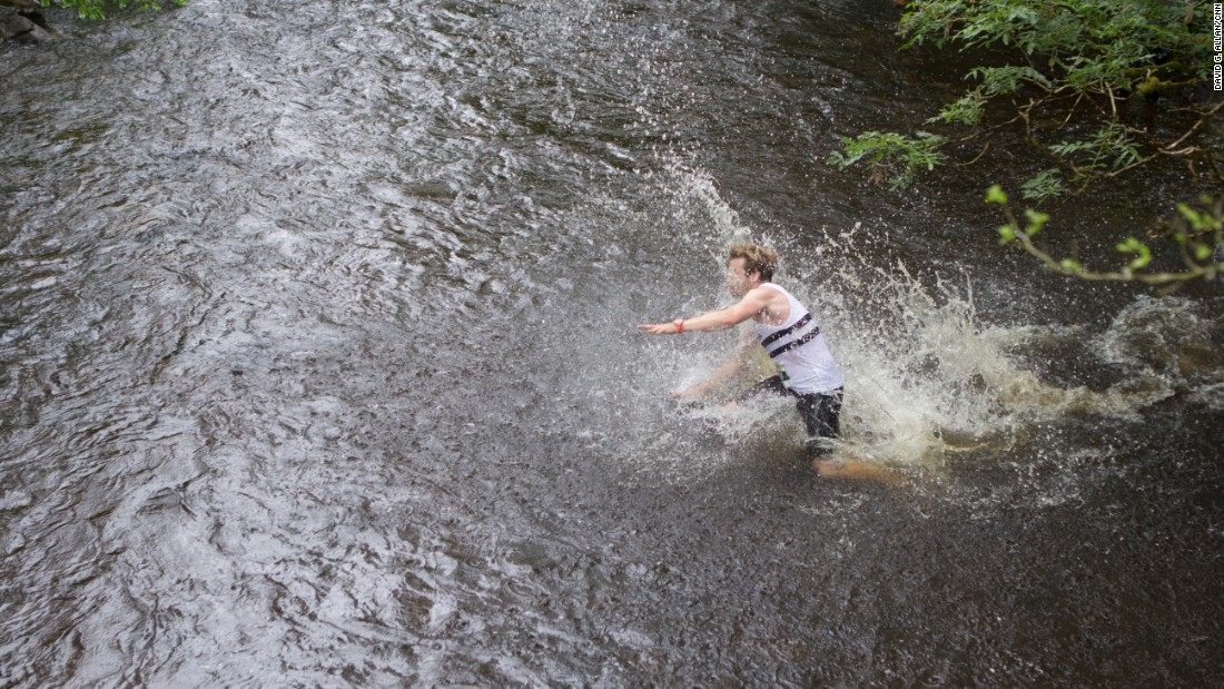 By the time they reach the last two miles and hit the waist-high river crossing, many of the racers fall down, buckling under weakened legs.<br />