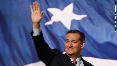 Sen. Ted Cruz (R-TX) waves to the crowd as he walks on stage to deliver a speech on the third day of the Republican National Convention on July 20, 2016 at the Quicken Loans Arena in Cleveland, Ohio. Republican presidential candidate Donald Trump received the number of votes needed to secure the party's nomination. An estimated 50,000 people are expected in Cleveland, including hundreds of protesters and members of the media. The four-day Republican National Convention kicked off on July 18.