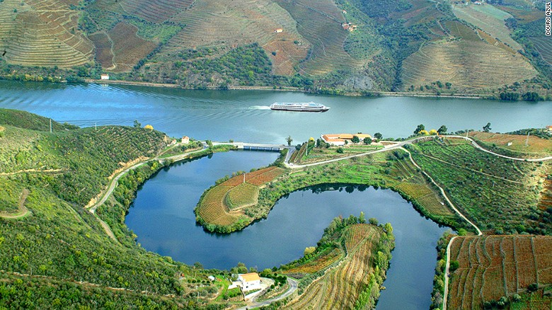 "Snaking 200 miles through northern Portugal, Rio Douro (or ""river of gold"" in English) may be the world's most beautiful wine region."