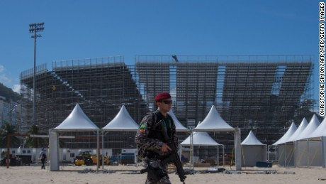 Policemen patrol the surroundings of the Beach volley stadium structure which will host the Olympic competition, at Copacabana beach in Rio de Janeiro on July 8, 2016.  / AFP / CHRISTOPHE SIMON        (Photo credit should read CHRISTOPHE SIMON/AFP/Getty Images)