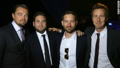 DiCaprio stops to pose for a pic with Johan Hill, Tobey Maguire and Edward Norton.