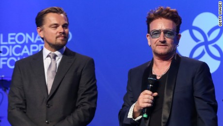 DiCaprio takes the stage with Bono. The Leonardo DiCaprio foundation raised over $45 million to support environmental projects.
