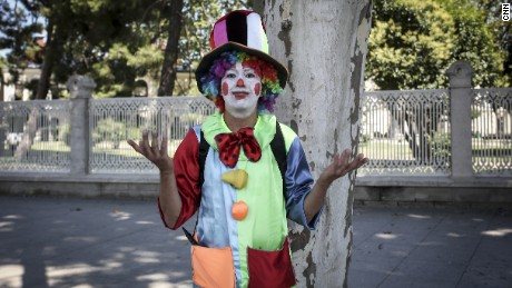 Tolga, a professional clown, poses for a photo, in Istanbul.