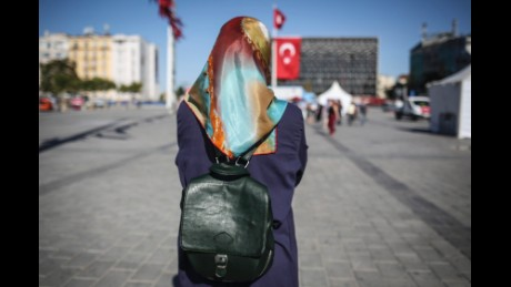 """Nurgul, age 27, a Kurdish waitress, poses for a photo in Taksim Square, in Istanbul, Turkey, Thursday, July 21, 2016. Nurgul said: """"We aren't exactly pleased with the way the president handled the situation. The State of Emergency decision is not right. Instead of re-establishing democracy, they declared a state of emergency. This is not a solution. Yes there was a coup attempt and people are worried and the state of emergency could be to calm the situation or for Erdogan to control the power. This isn't a good thing at all. I'm Kurdish, I know what it means to live under a State of Emergency. So I was worried leaving my house this morning. Yes, we are worried about our future because we are at a point in time where we can't imagine what will happen next in Turkey."""""""