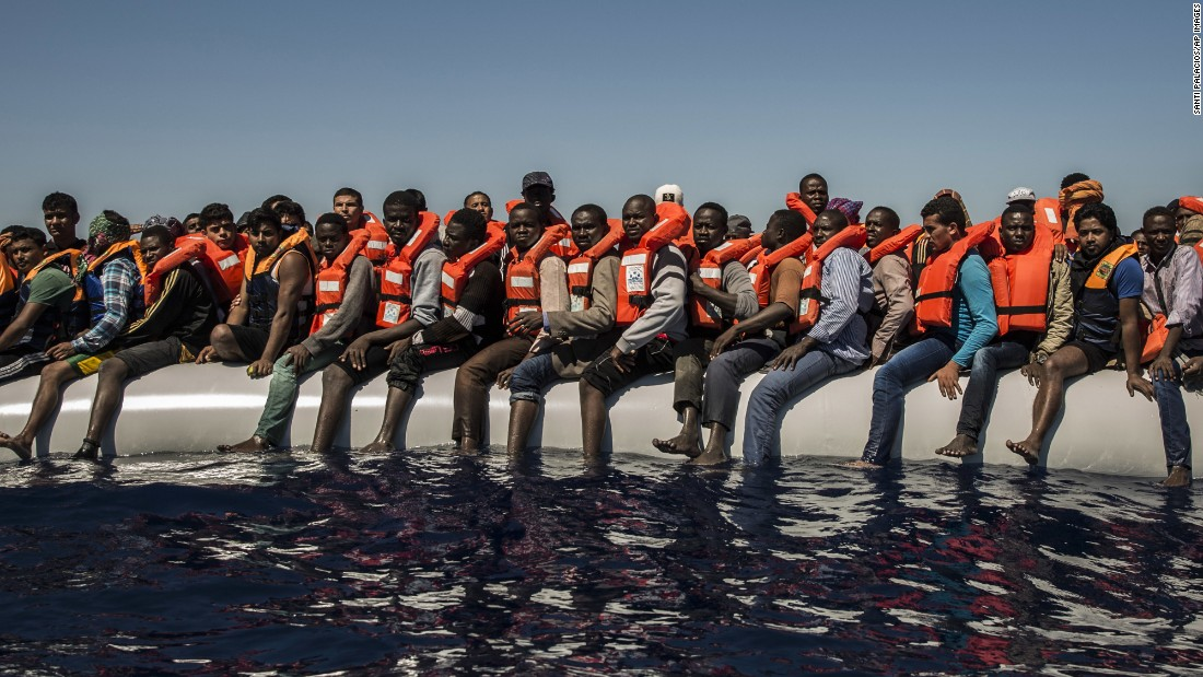 """Migrants sit on a dinghy Tuesday, July 19, waiting to be rescued in the Mediterranean Sea near Libya. <a href=""""http://www.cnn.com/2015/09/03/world/gallery/europes-refugee-crisis/"""" target=""""_blank"""">Europe's migration crisis in 25 photos</a>"""