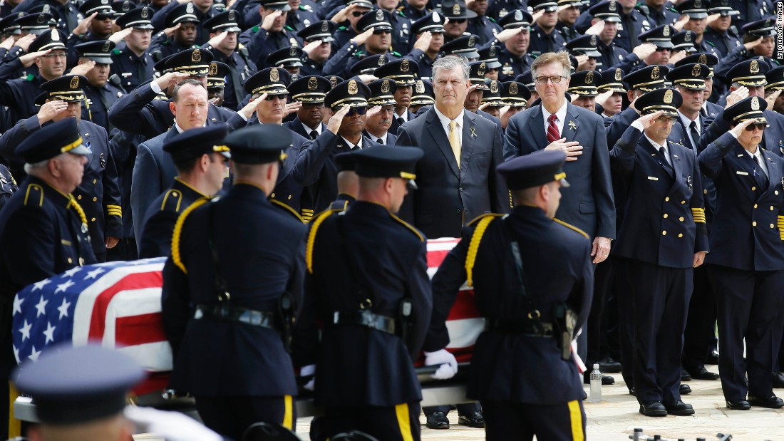 """An honor guard carries the flag-draped casket of Dallas police officer Michael Krol on Friday, July 15. Krol was one of the five Dallas police officers <a href=""""http://www.cnn.com/2016/07/20/us/dallas-shooter-micah-johnson-movements/"""" target=""""_blank"""">killed by a gunman</a> earlier this month."""