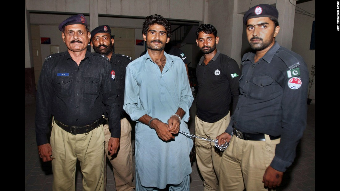 """Waseem Azeem, the brother of social media star Qandeel Baloch, is pictured with police after his arrest in Multan, Pakistan, on Sunday, July 17. He <a href=""""http://www.cnn.com/2016/07/18/asia/pakistan-qandeel-baloch-brother-confession/"""" target=""""_blank"""">confessed to killing his 25-year-old sister</a> because he said she was """"bringing dishonor"""" to the family. Qandeel referred to herself as a """"modern-day feminist"""" and had nearly 750,000 followers on Facebook."""