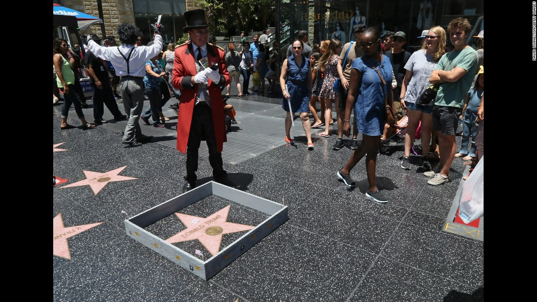 """A tiny wall <a href=""""http://www.cnn.com/2016/07/20/politics/donald-trump-hollywood-walk-of-fame-star/index.html"""" target=""""_blank"""">was placed around Donald Trump's star</a> on the Hollywood Walk of Fame on Tuesday, July 19, the day he became the Republican Party's presidential nominee. The wall, complete with barbed wire and """"Keep Out"""" signs, was constructed by popular Los Angeles street artist Plastic Jesus. The wall alludes to one of Trump's most controversial proposals -- the erection of a wall at the U.S./Mexico border."""